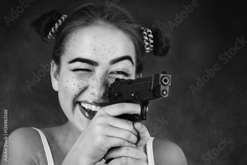 Keuken foto achterwand Vlinders in Grunge fun teenager girl with gun on black background, monochrome
