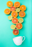 citrus fruits flying in a cup of tea. Concept