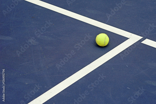 tennis ball at the corner of court Poster