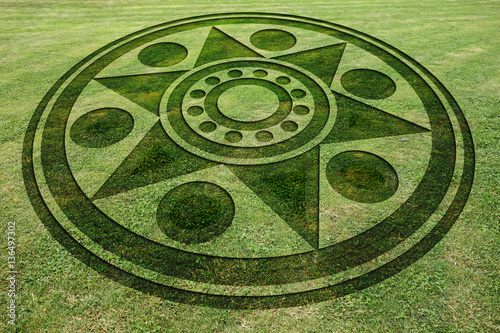 Deurstickers UFO Concentric circles star fake crop circle in the meadow