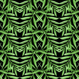 Seamless floral pattern with watercolor palm leaves. Tropical foliage arranged in chevron ornament, monochrome green on black background. Textile design.