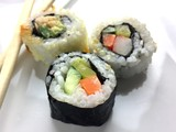 Sushi with chopsticks on a white plate