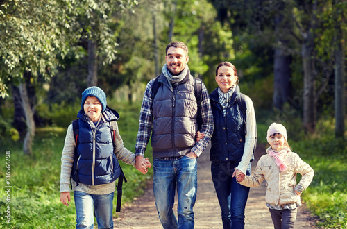 happy family with backpacks...