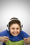 The boy is listening music with headphone