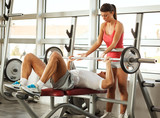 Young man and woman  doing  chest workout on bench press.Assist each other