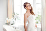 Beautiful bride in gorgeous wedding dress indoors. Wedding fashion