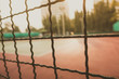 Golden hour Defocused and blurred image for background of tennis and basketball court behind grille and blur creamy sunflare