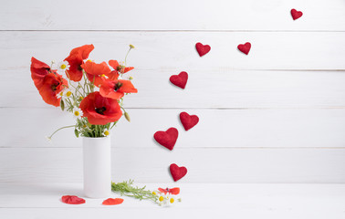 Card for Valentine Day. Poppies in vase and hearts.