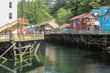 Suspended houses above a small river from Skagway, Alaska