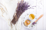 Honey comb on a plate with the Colors of Lavender and tea with lemon.sweet food.selective focus.