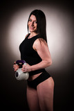Fit woman woekout with dumbbell weight over dark studio backgrou