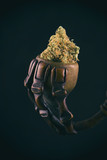 Cannabis bud on rustic pipe isolated over black background - med