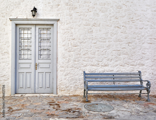 Greece, vintage wooden door and bench