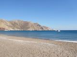 The sandy beach of Eristos, in Tilos, Dodecanese archipelago in Greece - 136661509
