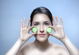 woman beauty face with cucumber