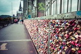 Thousands of love locks which sweethearts lock to the Hohenzollern Bridge to symbolize their love in Koln, Germany