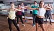Positive people learning zumba steps
