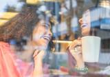 Happy women laughing drinking tea