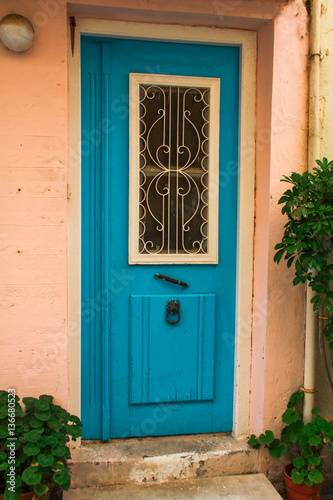 old blue wooden vintage painted door of greek island, Crete, Greece, traditional colorful facade