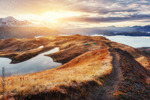 Fototapeta The path leading ridge pass Goulet at sunset. Upper Svaneti, Geo