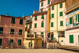 Colorful houses in Riomaggiore, Cinque Terre, Italy. Graffiti painting decorates the wall.