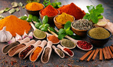 Variety of spices and herbs on kitchen table - 136698752