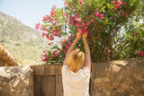 woman picking flowers