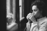 B&W  portrait of beautiful woman who drinks coffee close to the