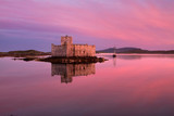 Kisimul Castle on Barra in the Outer Hebrides of Scotland is a formidable fortress founded in 1039 and situated on an islet facing the village of Castlebay.