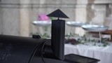 Smoke coming out of a chimney of a heating device at the wedding catering in Italy, selective focus, 4K