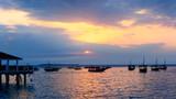 Typical boats of Zanzibar at sunset