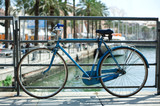 Blue bicycle near railing on a bridge