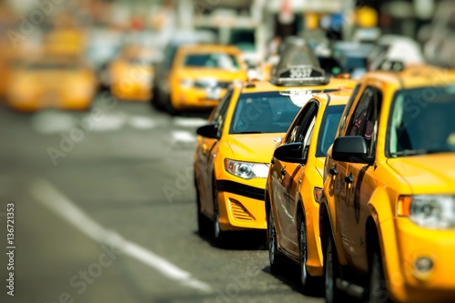 Papiers peints New York TAXI Yellow cab speeds through Times Square in New York, NY, USA.