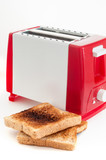 Two burned toasts near toaster