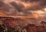 Storm clouds, Rainbow and warm sunlight at sunset all came together to create this dramatic scene at the Cape Royal viewpoint on the North Rim of Grand Canyon national Park in Arizona