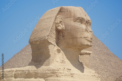 Closeup view of the Sphinx head with pyramid in Giza near Cairo, Egypt