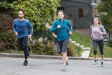 Group of friends running together outside