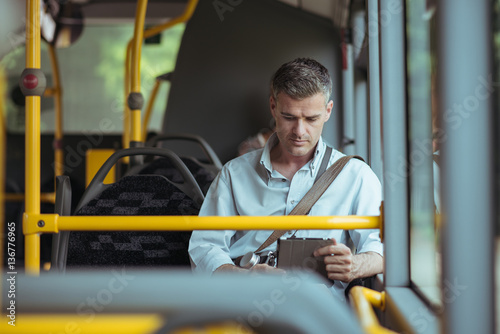 Poster Businessman traveling by bus