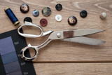 Tailor tools isolated on wooden background