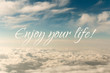 Inspirational motivation quote, enjoy life, on an abstract sky background