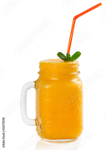 Cold smoothie from orange fruit.