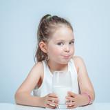 beautiful cute little girl drinking milk