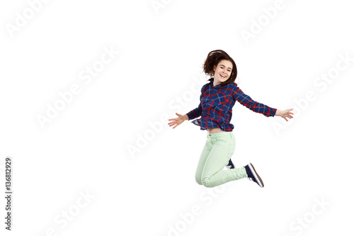Poster Young woman jumping on white background
