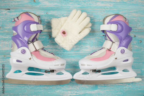 Kids ice skates with adjustable size and accessories on the wooden floor Poster