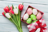 Easter eggs and colorful tulips