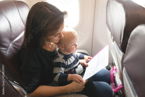 Mom and baby daughter are flying together