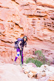 Backpacker tourist woman standing desert stone canyon mountain travel