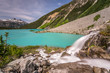 Waterfall from Matier glacier melt water flowing into the Turquoise Upper Joffre Lake in Beautiful British Columbia, Canada