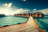 Water bungalows resort at islands. Indian Ocean, Maldives - 136866523