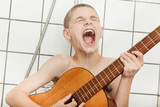 Loud child singing and playing guitar in shower - 136869384
